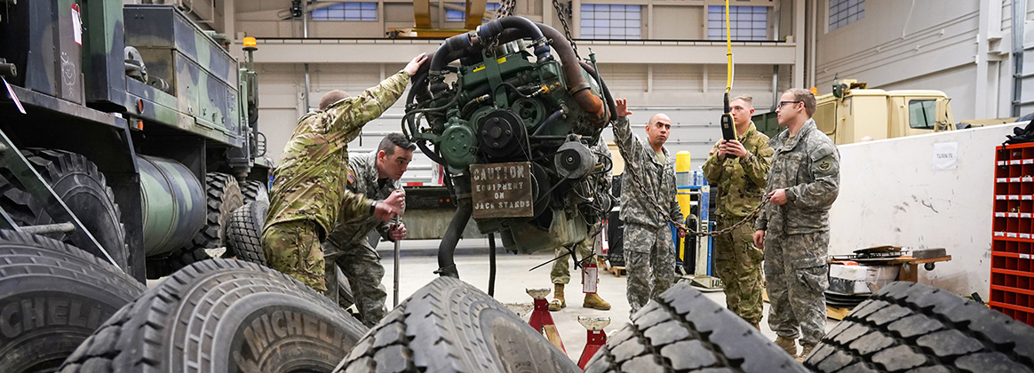 Soldiers Repair Heavy Expanded Mobility Tactical Truck Engine